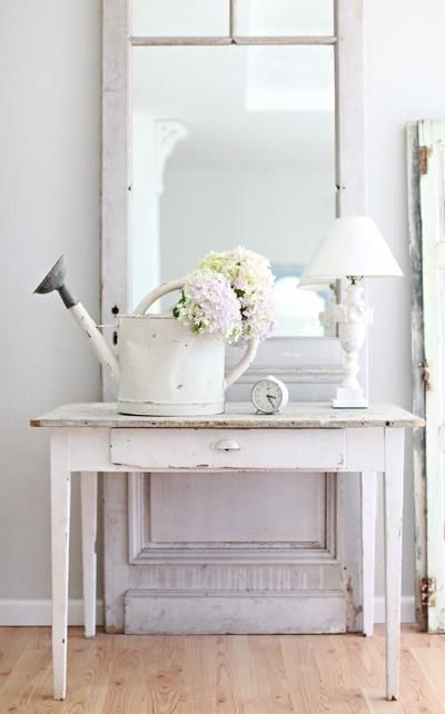 a whitewahsed watering can instead of a vase