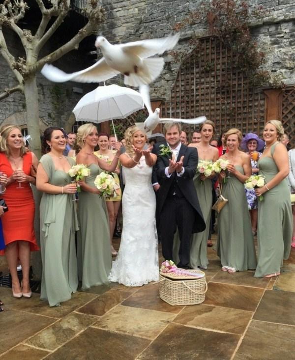 White wedding doves flying together