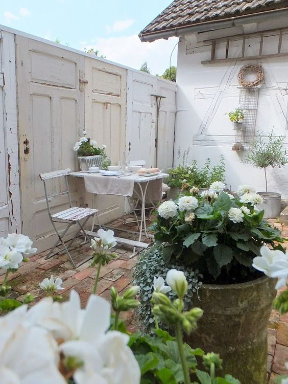 shabby whitewashed patio decorated with old doors