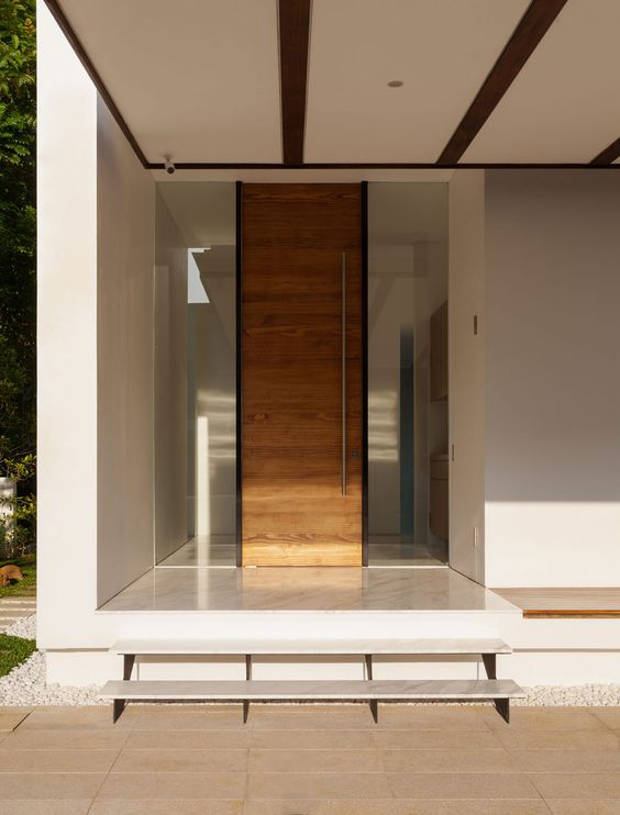 modern wooden entry door with wide sidelights