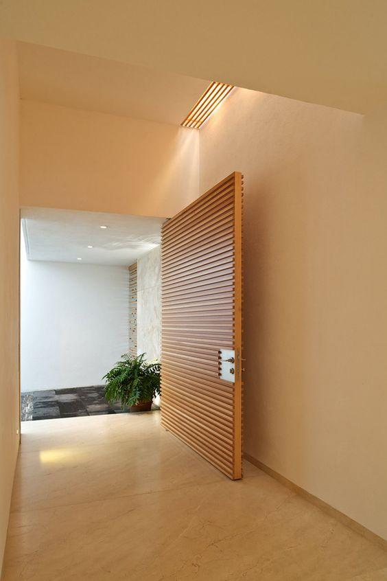 oversized wooden slab entry door