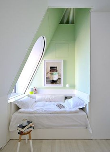 tiny sleeping and reading nook in the attic