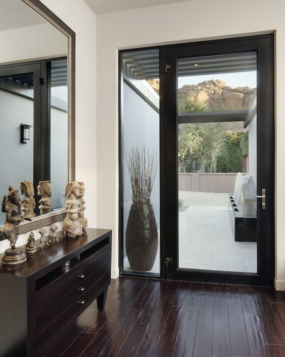 modern glass framed door with a sidelight