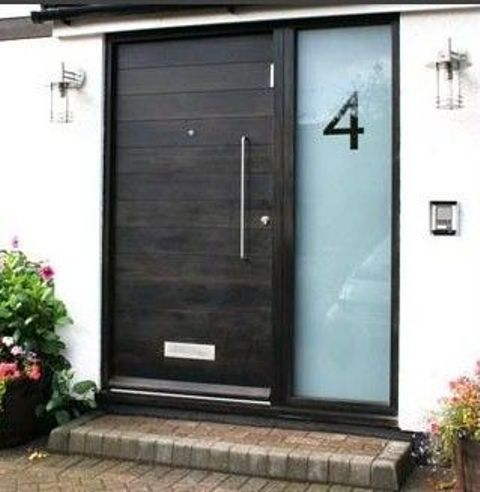 black wooden front door with an etched glass sidelight