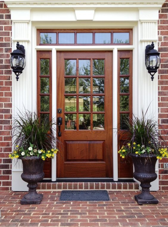 wooden stained glass front door with sidelights