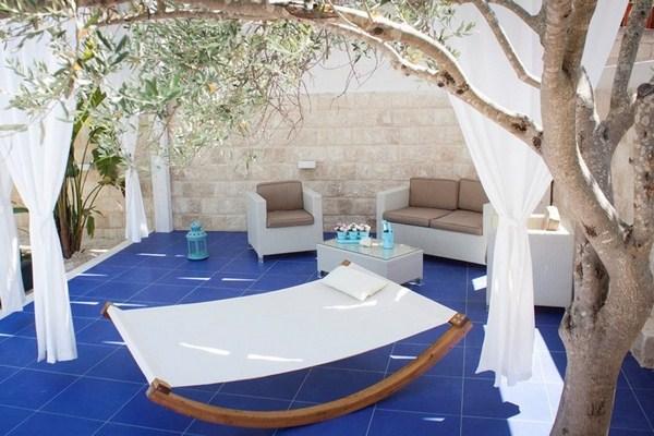 make terraced Mediterranean blue ceramic floor tiles rattan seating