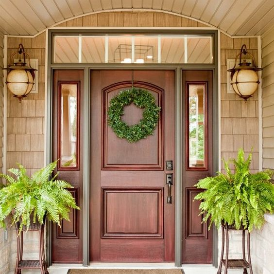 red wood front door with sidelights