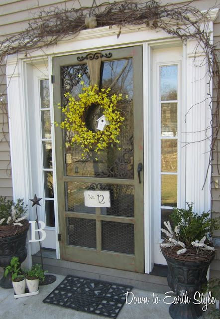 screen front door with white sidelights