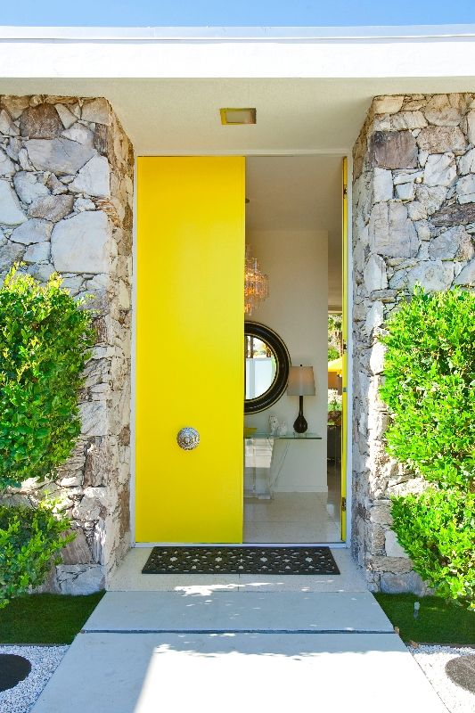 bold yellow front doors with antique handles