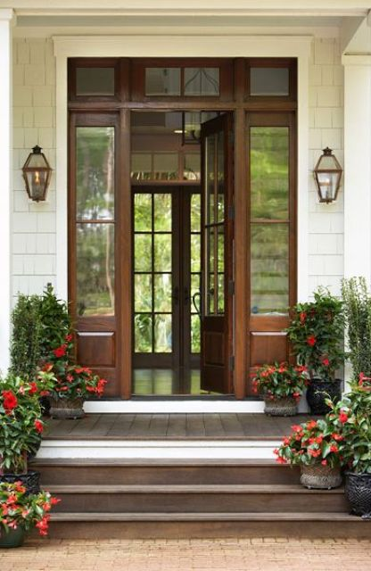 oversized frnt door with wooden sidelights