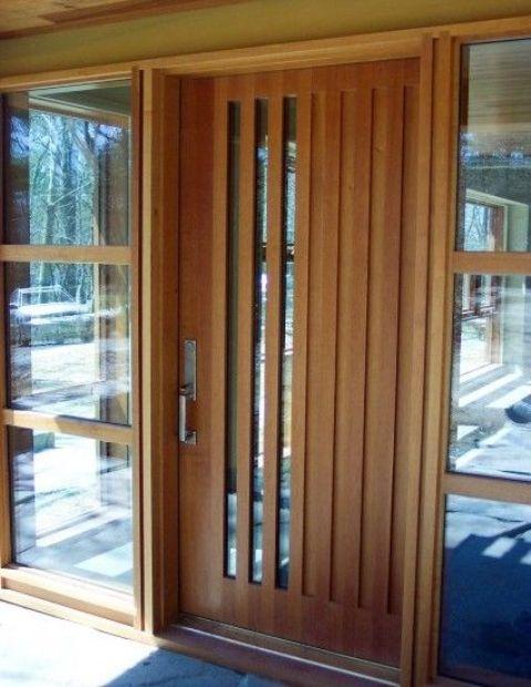 modern wood front door with vertical glass panes