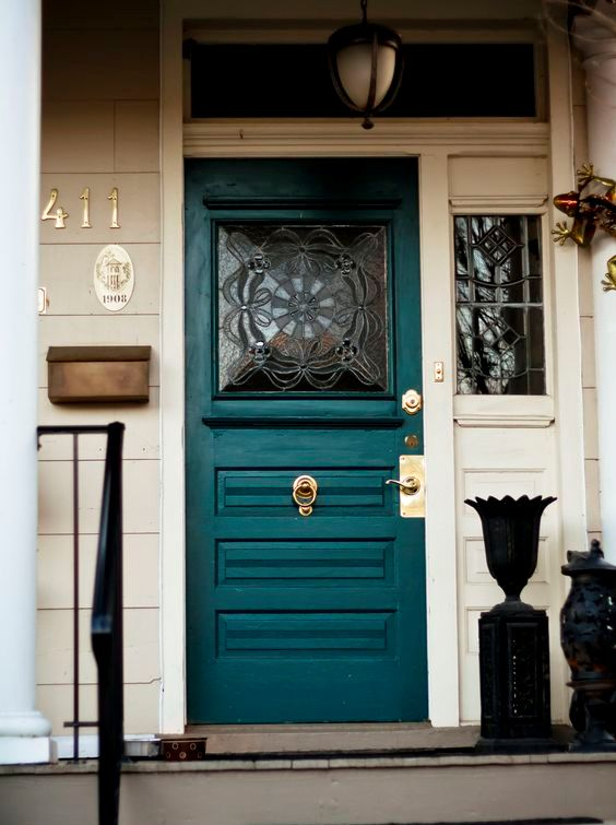vintage inspired teal glass front door