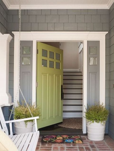 green front door with grey sidelights