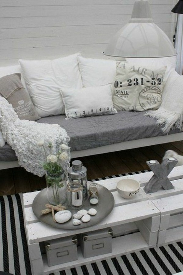 white coffee table designed by expanding palettes black and white carpet including