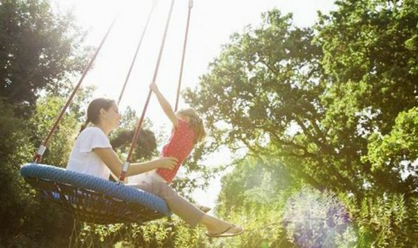Children swings mother and child