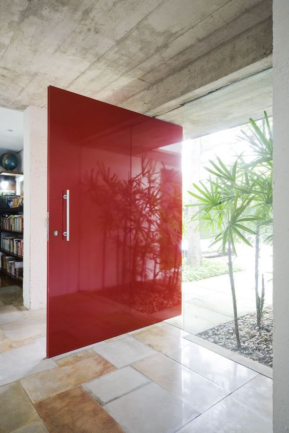 oversized bold red paneled front door