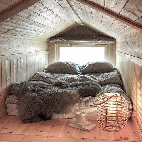 attic sleeping space with a bed on the floor