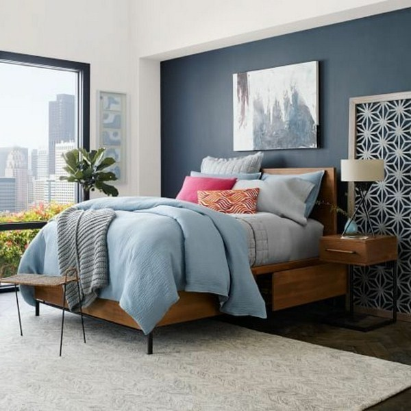 romantic bedroom with a comfortable upholstered bed with bed box