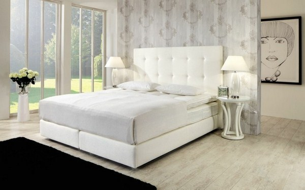 white model bed with storage space black chic carpet next