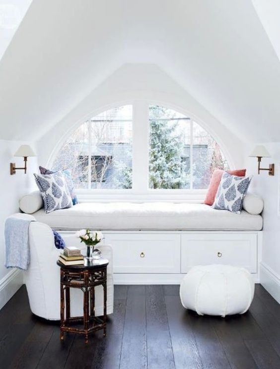 stylish white attic reading nook