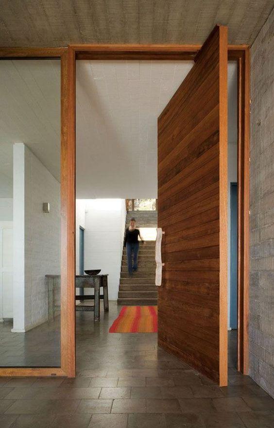 oversized wooden plank pivot front door