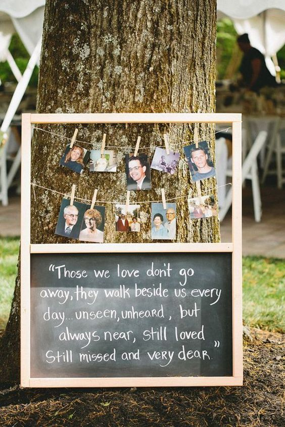 chalkboard wedding signs to honor deceased loved ones at wedding with their photos