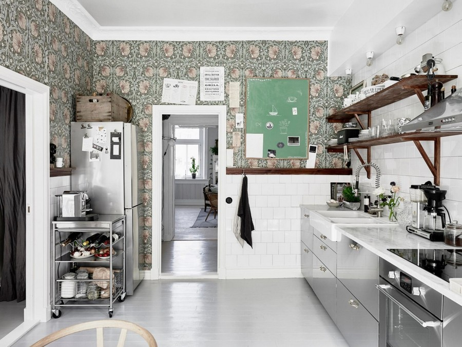 1-kitchen-wallpaper-wall-covering-ideas-in-interior-design-white-square-wall-tiles-wooden-open-racks-shelves-serving-trolley-floral-green-and-pink-pattern-motifs-glossy-cabinets