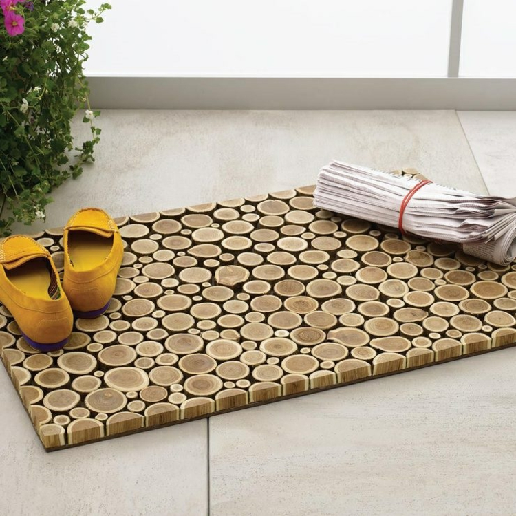 decoration with wood disks floor mat nature materials bathroom initially door