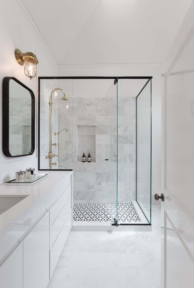 Elegant shower design with black window frame
