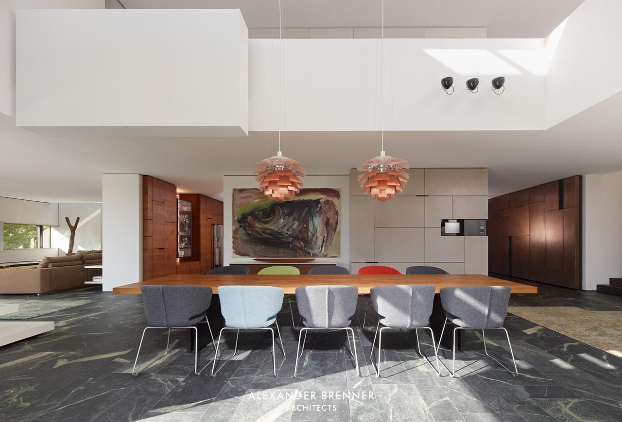 Dining table in modern villa by Alexander Brenner