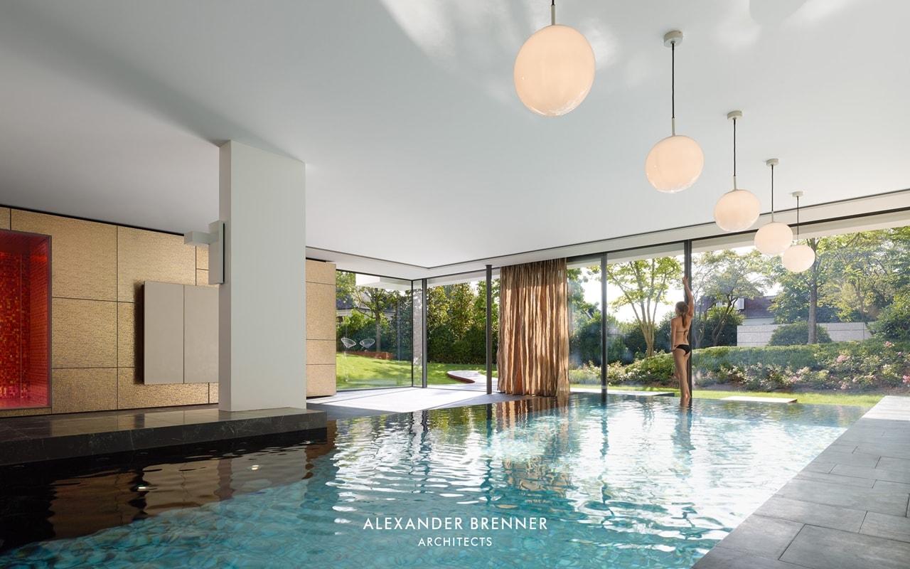 Indoor swimming pool in modern villa by Alexander Brenner
