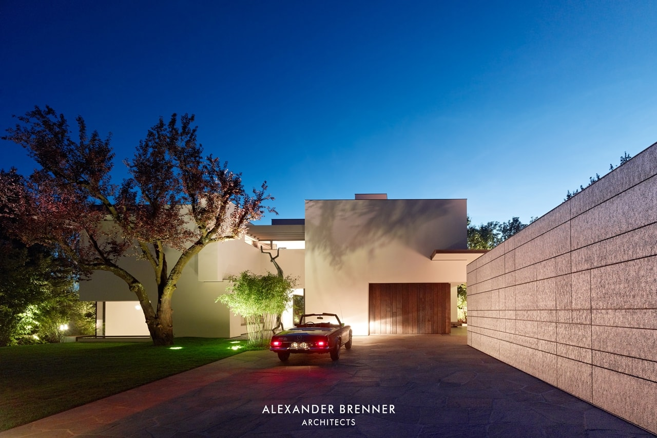 Driveway of modern villa by Alexander Brenner at night