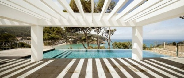 Pergola of wood by pool