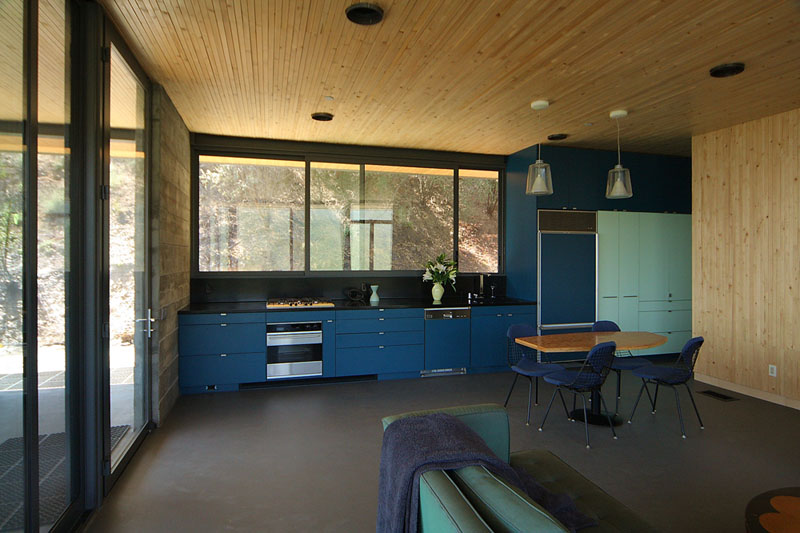 Two shades of blue have been used on the cabinets of this kitchen and tie in with the other uses of blue throughout the rest of the interior.