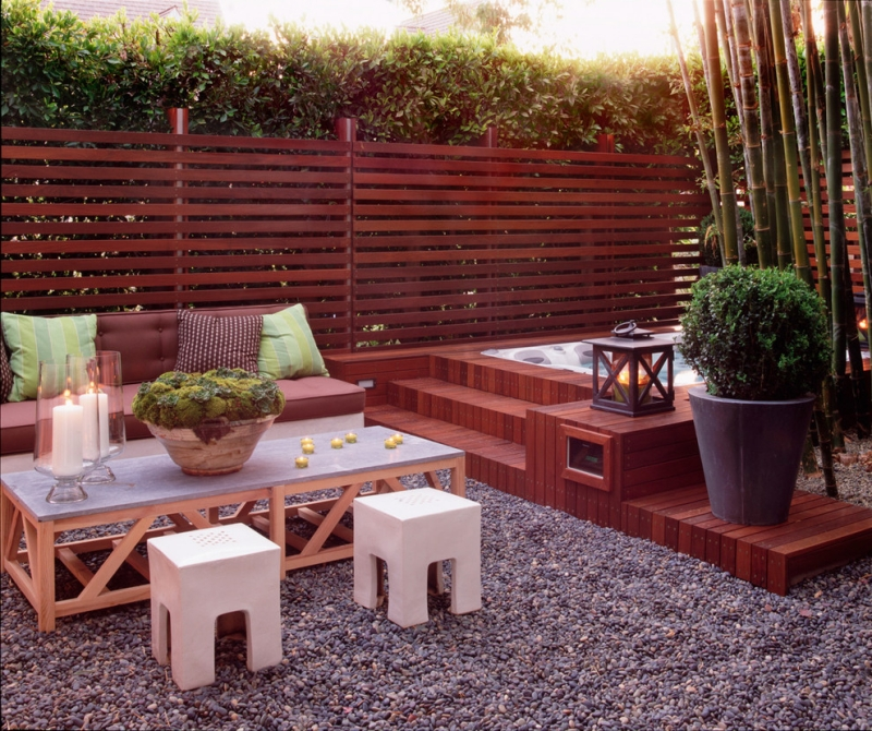 Seating-in-the-garden-gravel-bamboo-visibility-wooden furniture