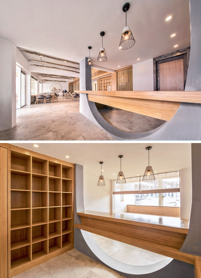 Inside this hotel, wood elements are abundant, and they have been paired with concrete and white walls for a modern and updated interior. #ModernHotel #HotelDesign #Wood #CurvedConcrete