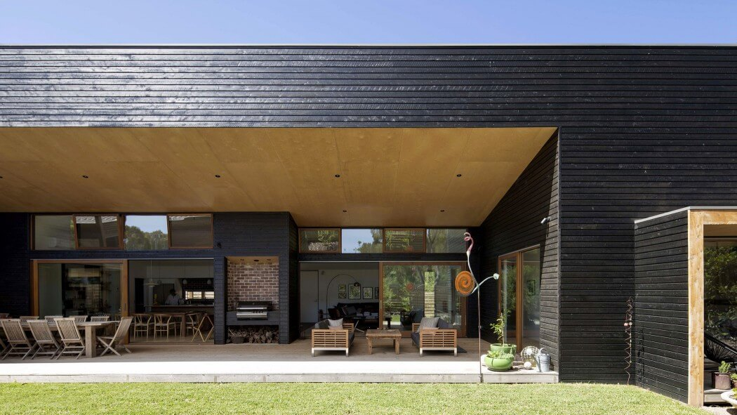 Open Plan Leads to Large Veranda in Bright House in Australia