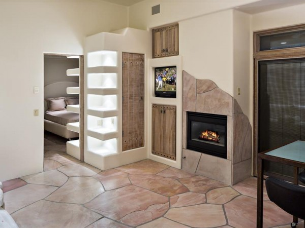 Flagstone accents being a little bit of depth to this build in fireplace.