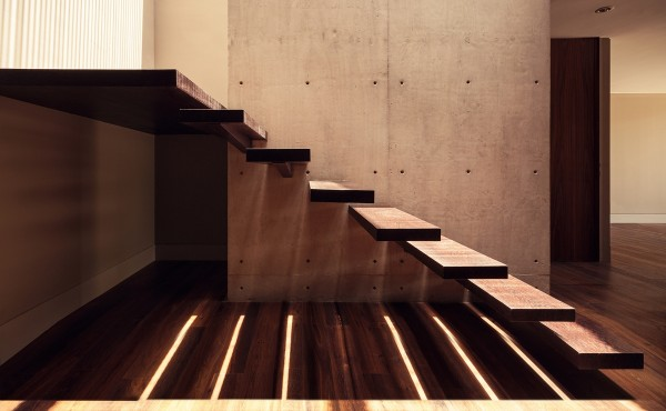 Inside, a floating staircase is just one more ultramodern touch.