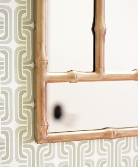 gold mirror and wallpaper