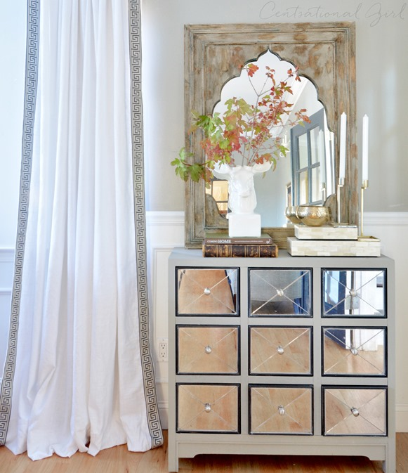 greek key panels and mirrored chest