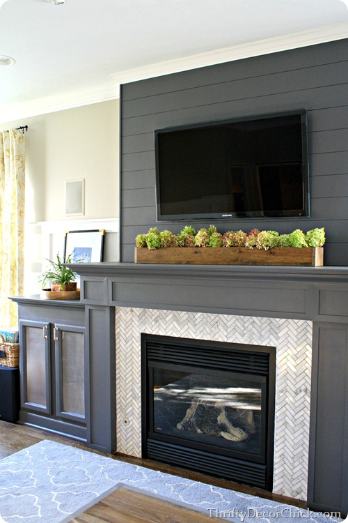 gray fireplace planked wall herringbone tile