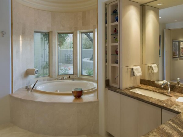 Travertine tiled bathrooms, and a private whirlpool are the final nest of luxury in this enviable home.