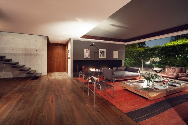 Inside we can see where the architect took cues from the modernism of the 1960's with this expansive open living area.