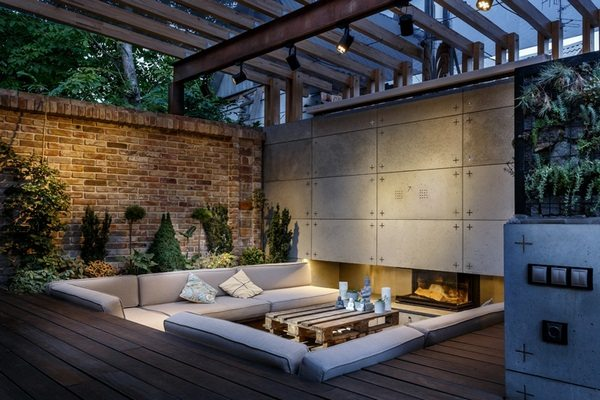 Outdoor Lounge With Sunken Seating Area And Fireplace