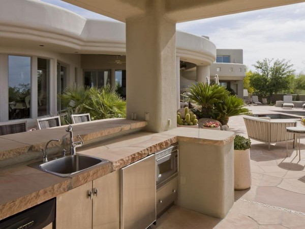 An outdoor wetbar and barbecue area is a dream for the grill enthusiast.