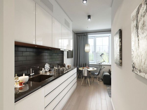The use of neutral colors which extends into the narrow kitchen makes the space