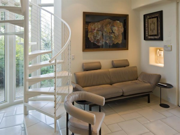 A spiral staircase hints at the overall modern style of the home.