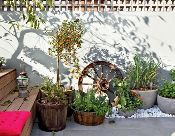 terrace balcony design modern orange tree plant floor tiles pebbles