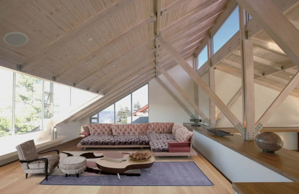 Top floor living room with upholstered furniture and carpet